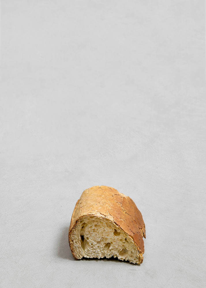 still.life. (a piece of bread) | UGO RONDINONE