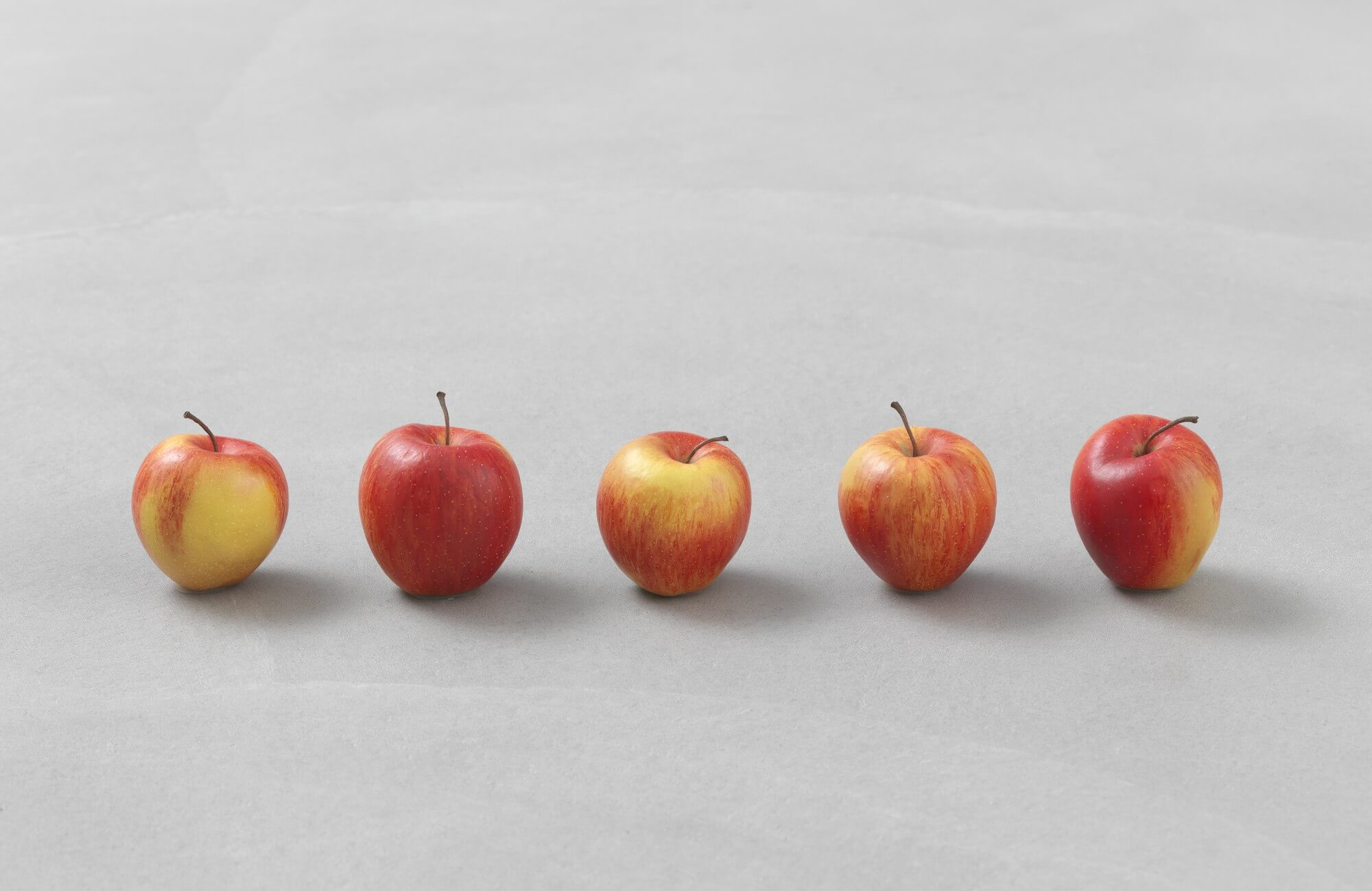 still.life. (five apples in a line) | UGO RONDINONE